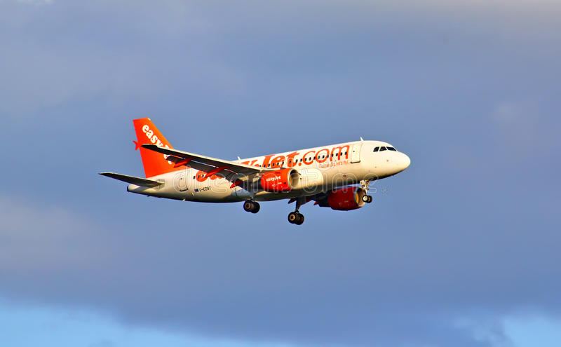 EasyJet Airline Airbus A319. BERLIN, GERMANY - AUGUST 12, 2014: EasyJet Airline Airbus A319 arrives to the Berlin Schoenefeld International Airport stock photo