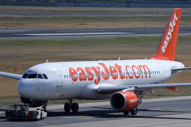 EasyJet plane being towed. Easyjet plane doing taxi on runway royalty free stock images