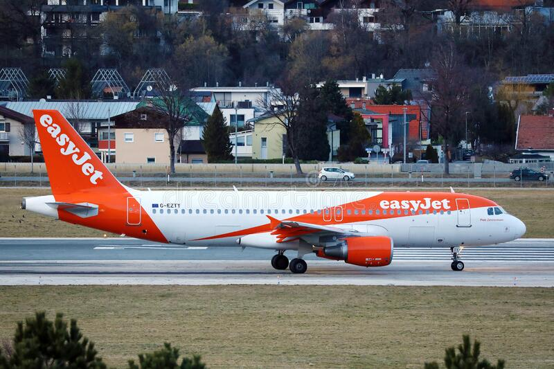 Easyjet plane taxiing in Innsbruck Airport, INN royalty free stock photography