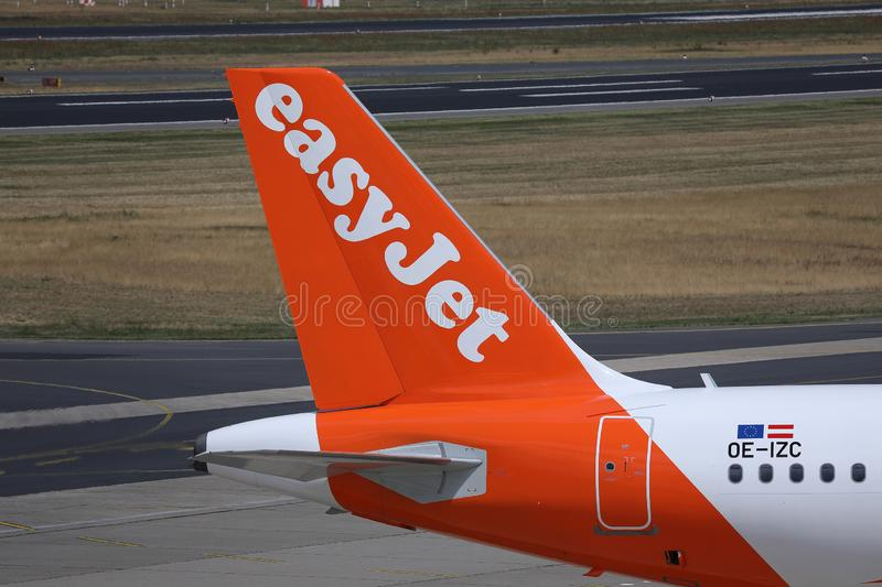 EasyJet plane, white livery, close-up view of tail. Easyjet, white livery plane doing taxi on runway royalty free stock image