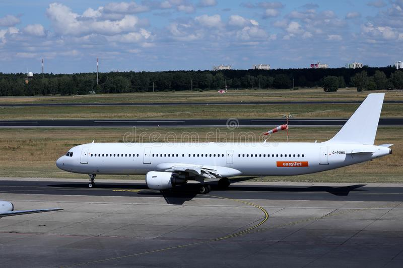 EasyJet plane, white livery. Easyjet, white livery plane doing taxi on runway stock photography