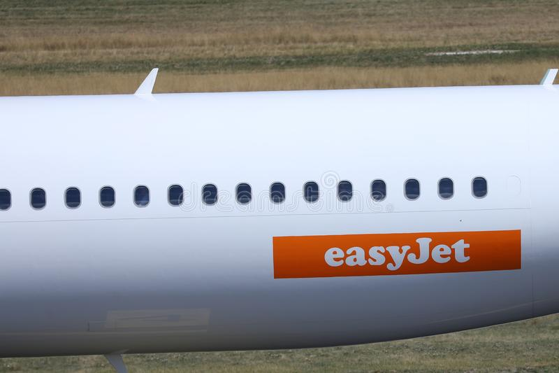 EasyJet plane, white livery, close-up view. Easyjet, white livery plane doing taxi on runway stock photo