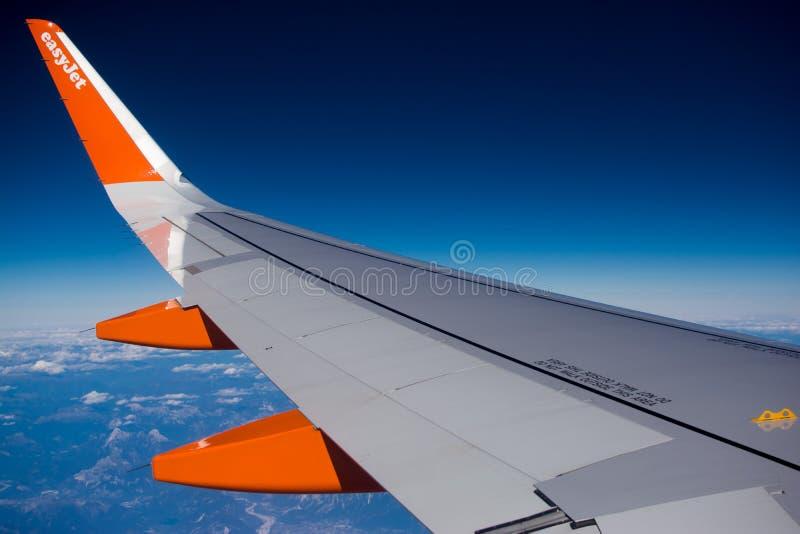 Easyjet wing. Easyjet airplane wing in flight royalty free stock photo