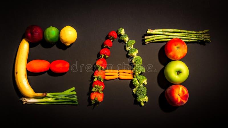 EAT a composé des fruits et légumes sains photos stock
