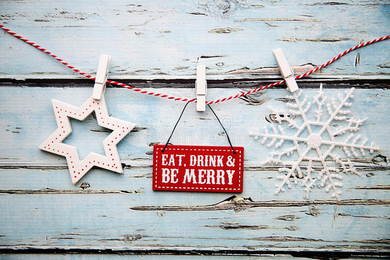 Eat drink and be merry sign. Eat, drink and be merry sign against a distressed wooden background stock image
