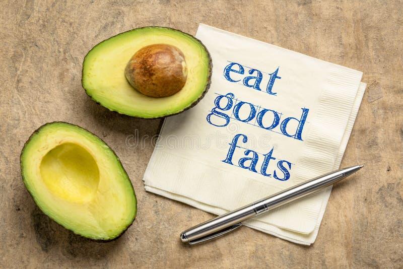 Eat good fats text on napkin royalty free stock photography
