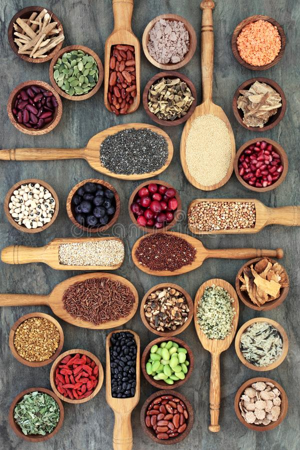 Eat Healthy Food. Healthy food concept with legumes, fruit, grains, cereals, medicinal herbs and spice. Foods high in omega 3 fatty acids, antioxidants royalty free stock photos