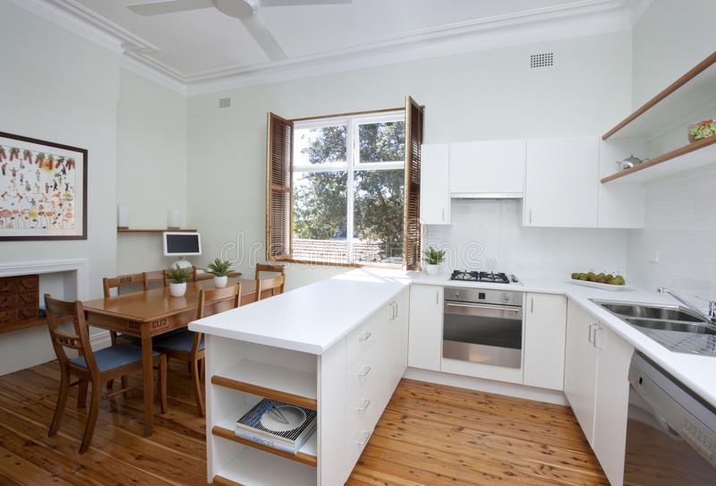 Kitchen Table Counter. A modern kitchen with a table and polished wood floor stock images