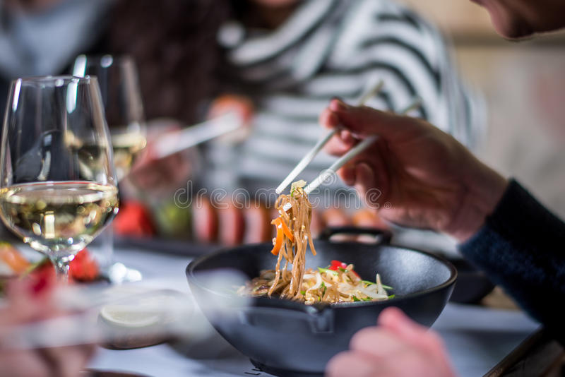 Eat noodles with chopsticks stock photo