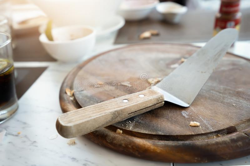 After eat of pizza from wooden tray royalty free stock photos