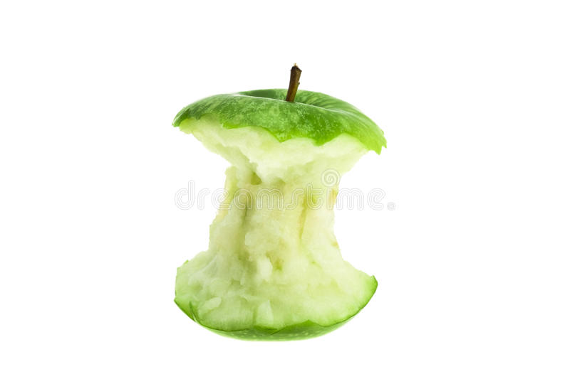 An eaten green apple core. Studio shot with a white background stock photo