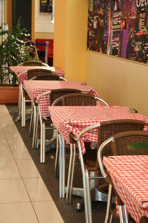 Eatery. Small eatery with few tables and chairs disposing along wall. Shot in Singapore royalty free stock photos