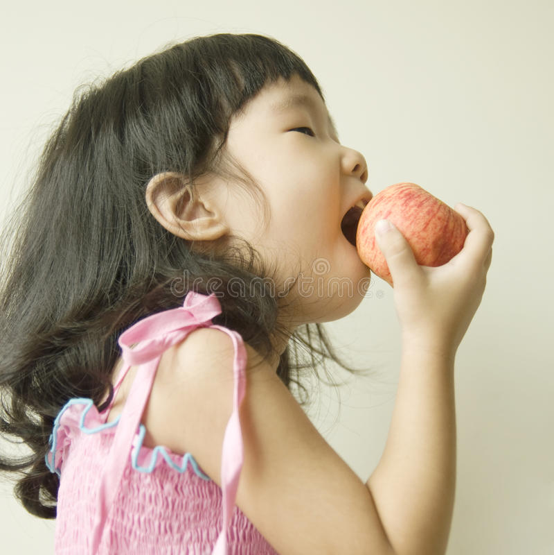 Eating apple stock photos