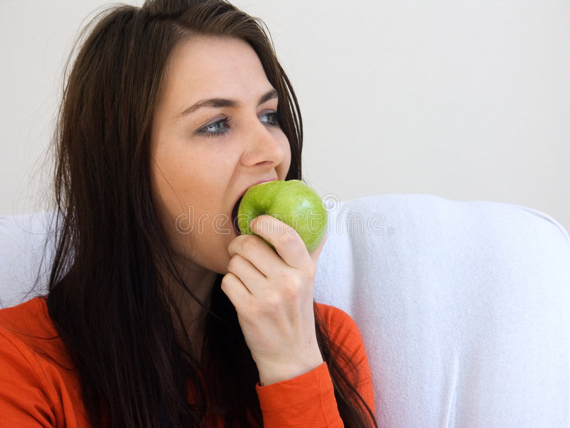 Eating a Apple stock photo