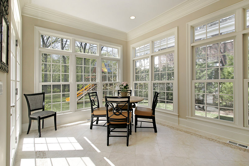 Eating area with several windows stock images