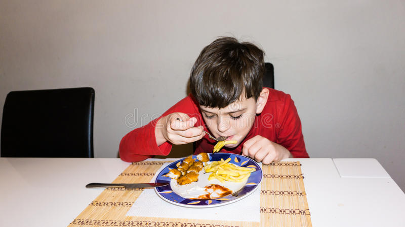 Eating autistic boy health nutrition child food son. Eating autistic boy health nutrition stock photo