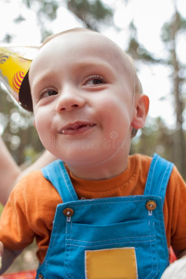 Eating baby nature picnic party concept. stock image