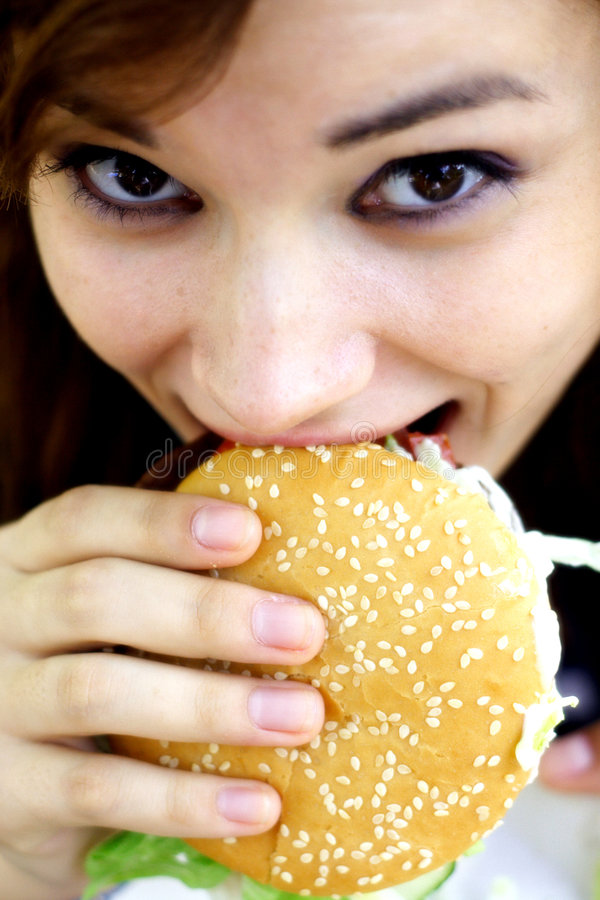Eating a burger royalty free stock photography