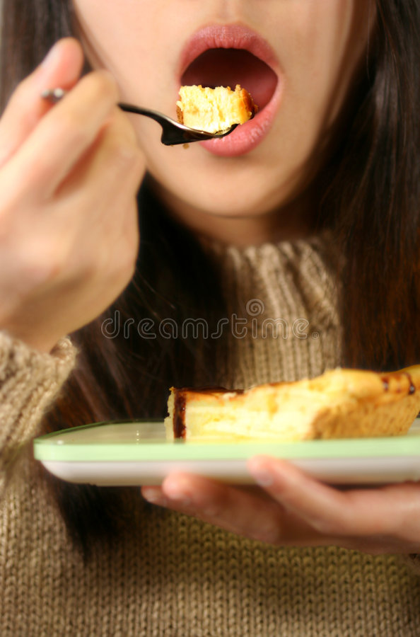 Eating cheese cake royalty free stock photo