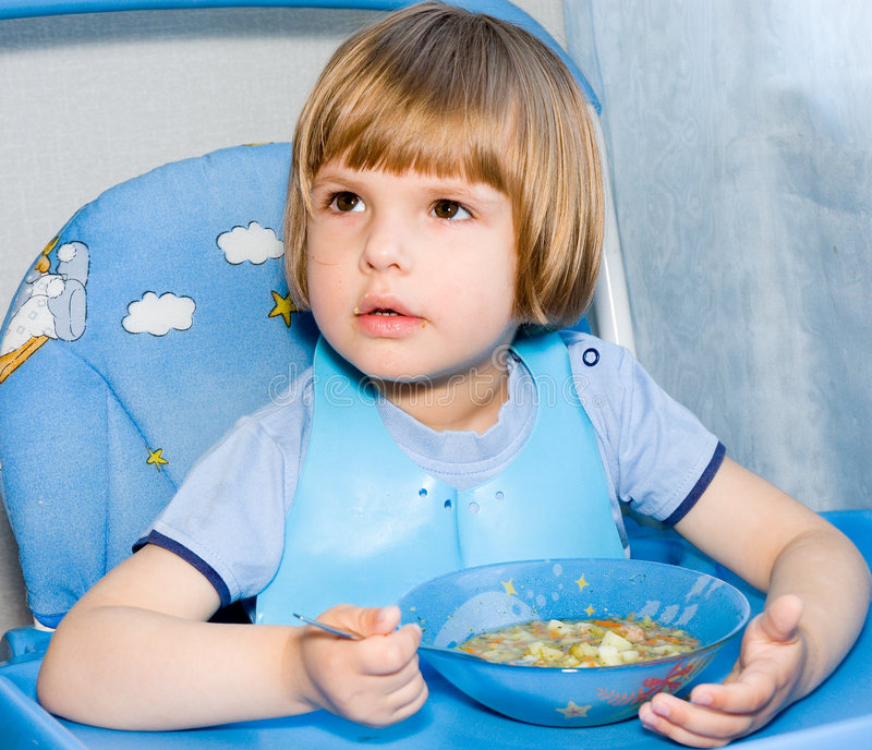 Eating child stock photography