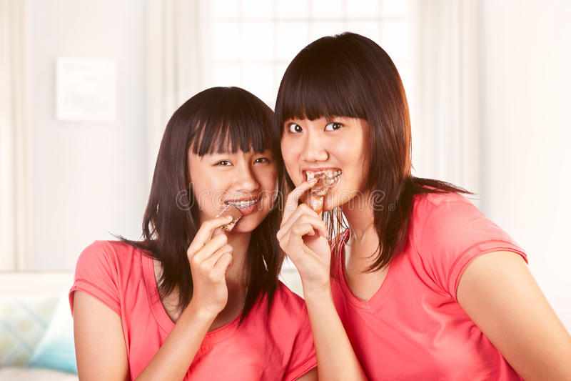 Download Eating chocolate stock image. Image of sister, casual - 19372027