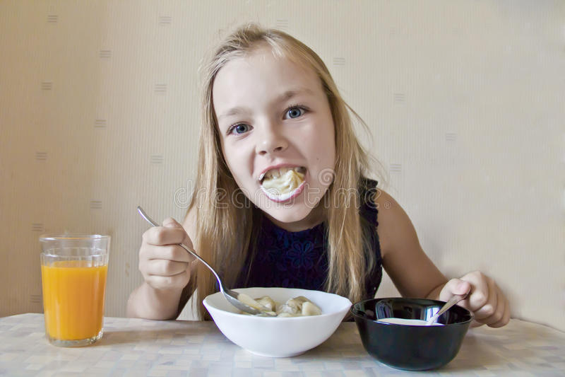 Eating cute girl stock image