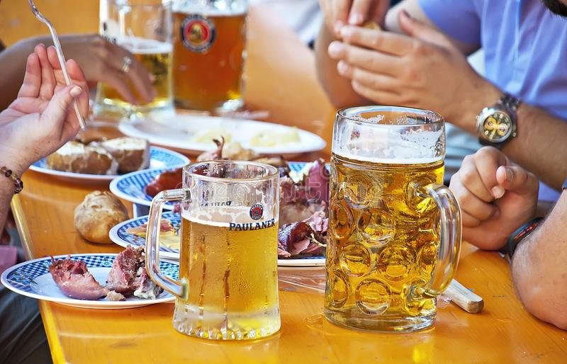 Eating and drinking at the Oktoberfest fair royalty free stock photography