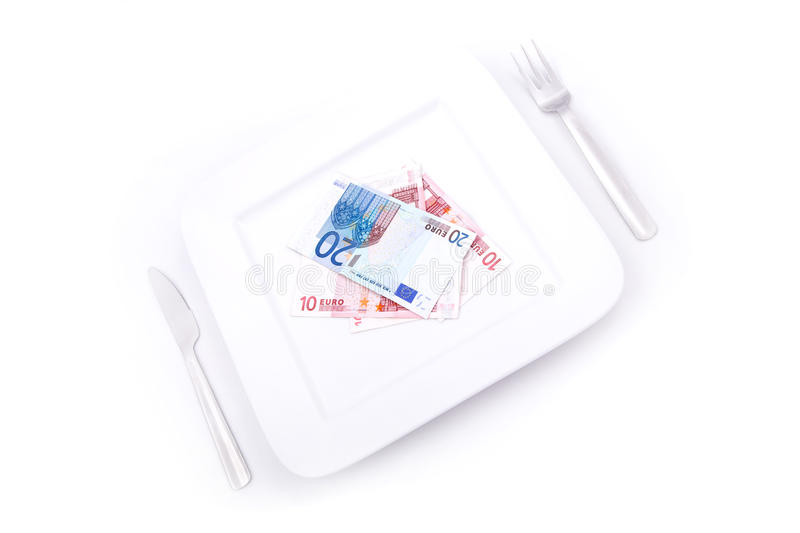 Eating Euros. Price of Food and eating wealth royalty free stock photography