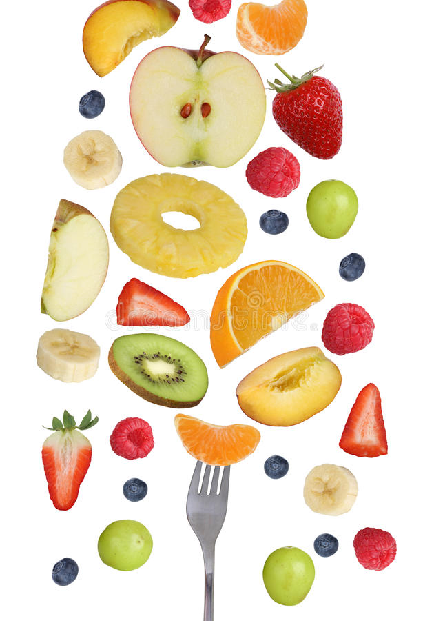 Eating falling fruits like apples fruit, oranges, banana and strawberry with fork stock photography