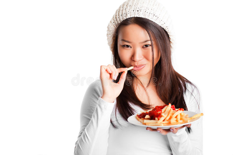 Eating french fries royalty free stock photography
