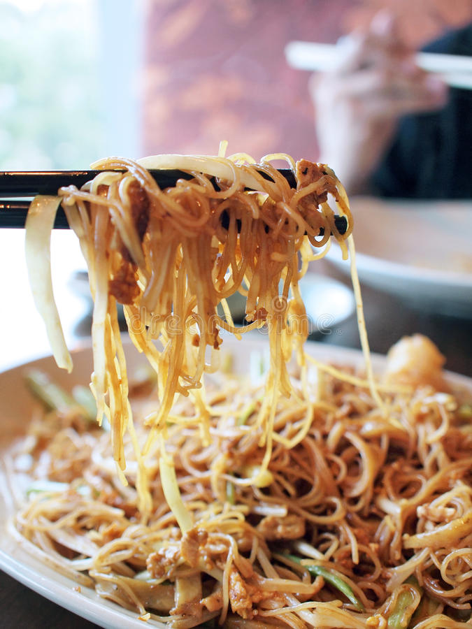 Eating fried vermicelli royalty free stock image
