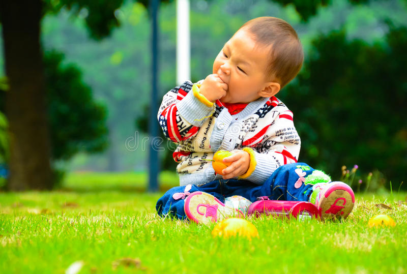 Eating fruit is good for health. Children in addition to eat ordinary food but also eat fruit, fruit is every baby likes to eat the nutrition and health of small royalty free stock photo