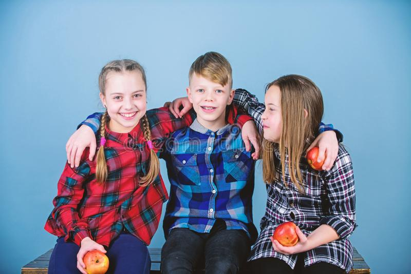 Eating fruits and vegetables benefits childrens health. Cute little children holding red apples. Apple is a health food. Natural food is good for childrens royalty free stock photos
