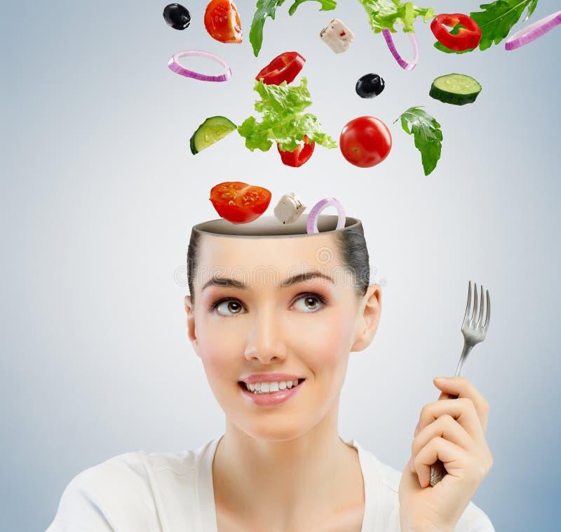 Eating healthy food. A beautiful girl eating healthy food stock image