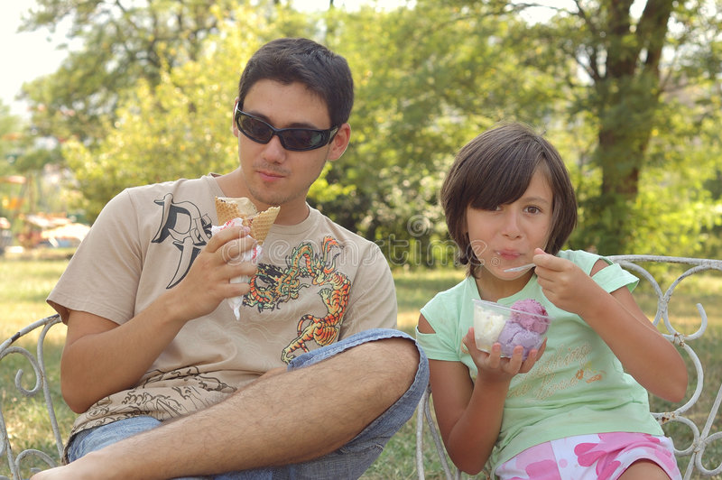 Eating ice cream in park royalty free stock photos