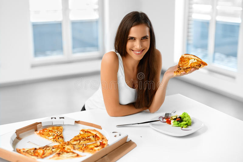 Eating Italian Food. Woman Eating Pizza. Fast Food Nutrition. Li stock images