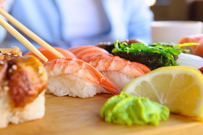 Eating japanese food stock image