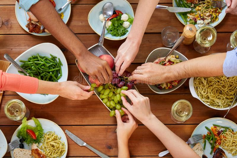 Group of people eating at table with food royalty free stock image