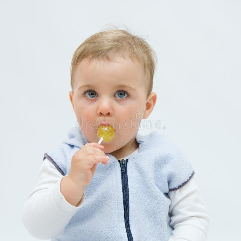 Eating Lollipop Royalty Free Stock Photo