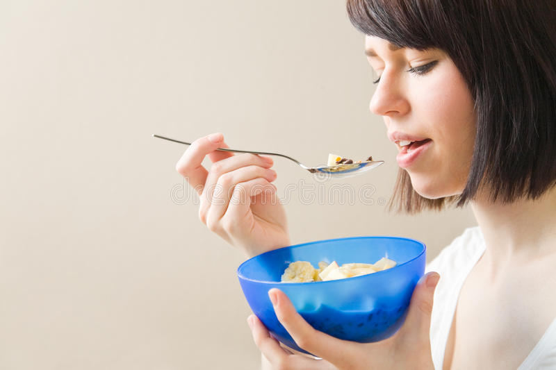 Eating muesli with a spoon royalty free stock images