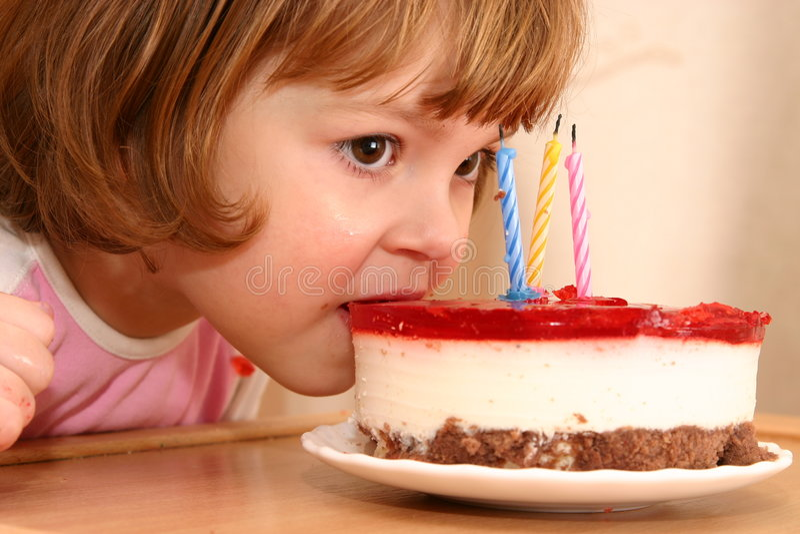 Eating my birthday cake stock image