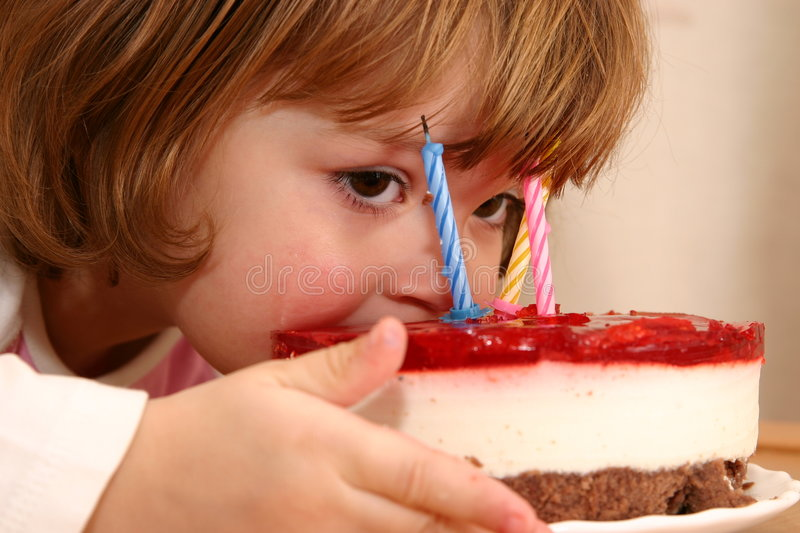 Eating my birthday cake. Little girl taking a mouthful of her birthday cake stock photography