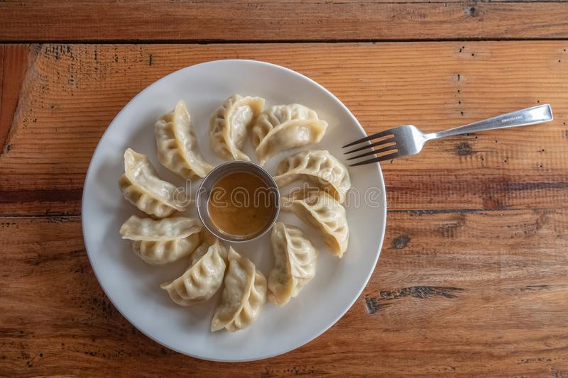 Eating Nepalese Traditional Dish Momo. Authentic Cuisine in Nepal royalty free stock images