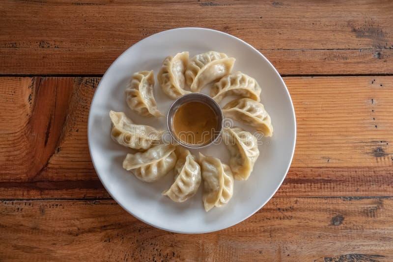 Eating Nepalese Traditional Dish Momo. Authentic Cuisine in Nepal. Eating Nepalese Traditional Dish Momo. Authentiuisine in Nepal royalty free stock image