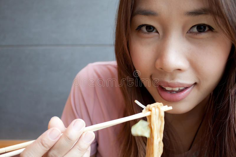 Eating Noodle stock photos