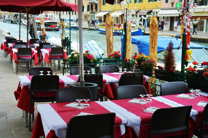 Eating outdoors, elegant restaurant, in Venice, Italy stock images