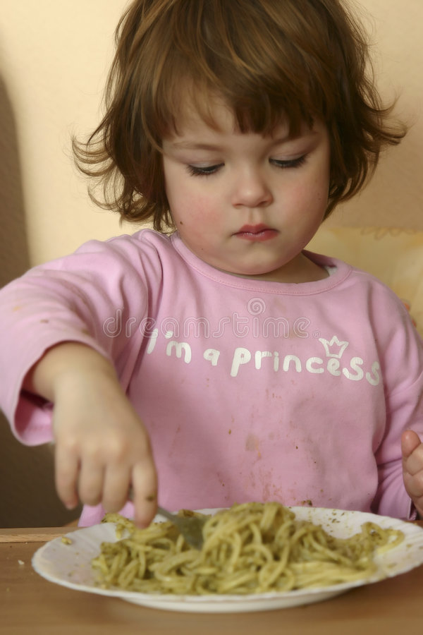 Eating pasta stock image