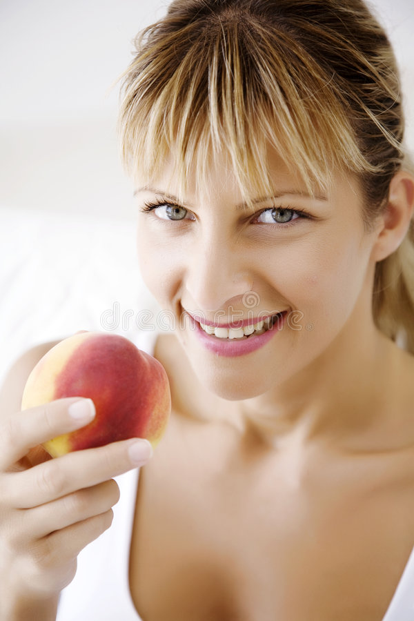 Download Eating peach stock photo. Image of fruit, holding, people - 7072624