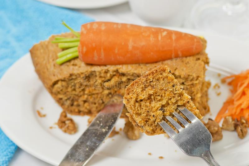 Eating a pice of Healthy Vegan Carrot Cake Loaf with Chopped spoon stock photo