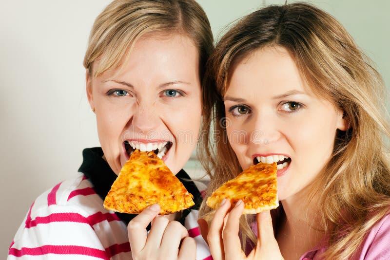 Download Eating Pizza stock image. Image of enjoy, slice, girls - 12357889